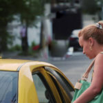 me5962304-1of-business-woman-calling-yellow-taxi-street-panama-hd-a0201